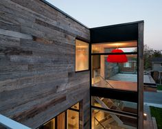 Wooden exterior. Large glass windows.