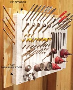 Great idea to use foam insulation to hold pointy tools and bits. Even if you don't hang it on the walls you could use it in a drawer to organize things and keep them from sliding around.