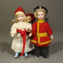 Pair of French All-Bisque Lilliputian Dolls in Original Costumes