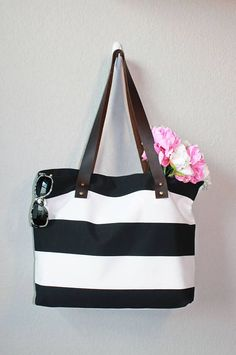 The Nicole Tote in Cabana Stripe. Large cotton canvas and leather tote in black and white is perfect for a diaper bag or shopping tote.