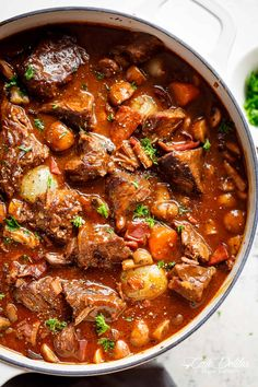 Tender fall apart chunks of beef simmered in a rich red wine gravy makes Julia Child's Beef Bourguignon an incredible family dinner.   cafedelites.com
