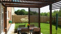 Contemporary pergola with Ikea Applaro table and chairs