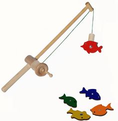 Wooden Fishing Rod Favorite has been redesigned and is better than ever! Made in the USA too:) www.pureplaykids.com