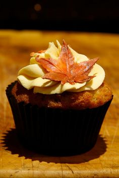 @Christy Bode fall leaf cupcake, something like this? and pumpkin spice with cream cheese frosting?