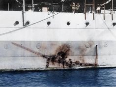 """Imprint of a Mitsubishi Kamikaze """"Zero"""" along the side of the H.S Sussex, a heavy cruiser with of reinforced steel at the point of impact. Nagasaki, Hiroshima, Photo Choc, Photo Avion, Sussex, Rare Historical Photos, Heavy Cruiser, Haunting Photos, Aircraft Carrier"""