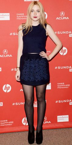 Dakota Fanning wearing Louis Vuitton's knit top and sparkling mini-skirt, stacked bangles and suede booties.