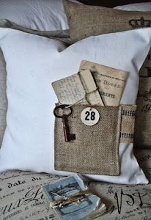Burlap pocket on throw pillow with old letters and keys. How creative!