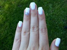 white nails with sparkle