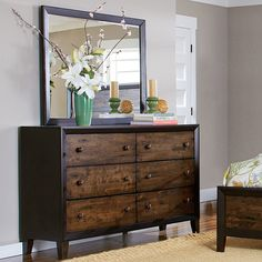 The rustic charm of this dresser and mirror from our Draven Collection is exemplified by the espresso finish, embossed solid wood panels and drifted oak finish. Modern functionality is evident with the use of ball-bearing slide glides.