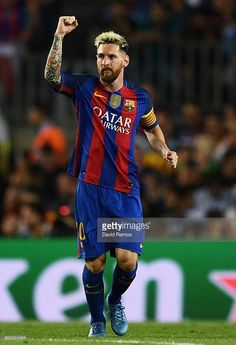 Lionel Messi of Barcelona celebrates scoring his sides first goal during the…