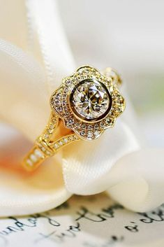 39 Beautiful Engagement Rings For A Perfect Proposal ❤️ beautiful engagement rings yellow gold round cut diamond halo vintage twisted pave band ❤️ More on the blog: https://ohsoperfectproposal.com/beautiful-engagement-rings/