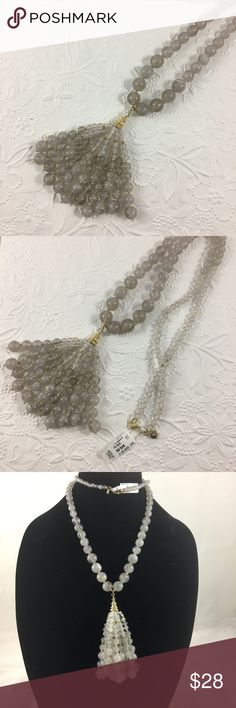 "Neiman Marcus Extra Long Bead Tassel Necklace. Brand new with tags. Extra long grey resin bead Tassel necklace. The Tassel is covered with a beautiful gold cap. It has a lobster closure. Necklace par is approximately 30"" with an additional 3"" drop from the Tassel pendant. It's very light weight. Neiman Marcus Jewelry Necklaces"