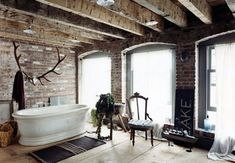 URBAN RUSTIC IN MANHATTAN - Dark, cozy Manhattam home belonging to Carter Smith. A farmhouse feel in the middle of the city – it's the perfect combination of urban meets rustic, and incredibly cozy. Bathroom Inspiration, Interior Inspiration, Bathroom Ideas, Bathroom Gallery, Bathroom Designs, Design Inspiration, Sunday Inspiration, Bath Ideas, Brick Bathroom