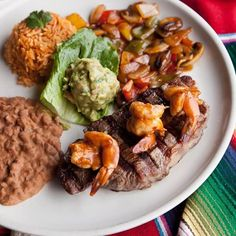 Try our delicious Steak Huasteco! A true gourmet dinner, featuring a top sirloin steak – flame-broiled and smothered with sautéed onions, green peppers, mushrooms and tomatoes. Crowned with garlic shrimp and served with rice and beans. Cheers to that with an El Mariachi margarita! Enjoy!