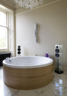 Now that's an idea. .surround sound and chandelier., Not to mention the Round Tub.