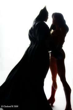 Batman and Wonder Woman in the shadows...