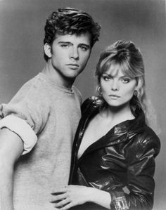 "Grease 2   Maxwell Caulfield and Michelle Pfeiffer, ""if you really want to know what I want in a guy, well, I""m looking for a dream on a mean machine with hell in his eyes"" :)"