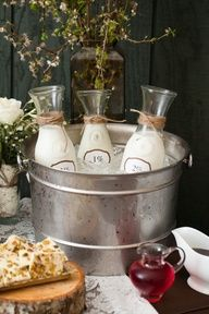 What a clever way to keep your creamers and milk cold while on a rustic coffee station!