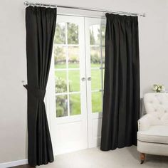 Block out external light to create a settled atmosphere in your home with our black faux silk blackout pencil pleat curtains.