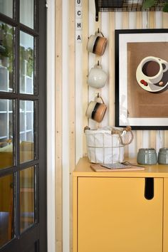 close up diy coffee station with yellow cabinet stoneware cups on hooks and storage basket with neutral coffee cup wall art Diy Projects On A Budget, Cool Diy Projects, Basket Shelves, Storage Baskets, Yellow Cabinets, Pretty Mugs, Fall Diy, Small Space Living, Coffee Cup