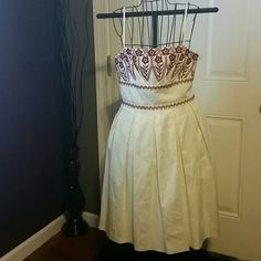 "Ann Taylor sz 8 Beautiful Summer dress Gorgeous cream dress with deep red embroidery, pleated skirt, gathered mid section, straight neckline, spaghetti straps  So cute!!! Bust: 16"" Waist: 16"" Length: 34.5"" Ann Taylor Dresses Midi"