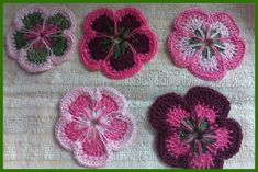 Spool pin doilies (pansies)