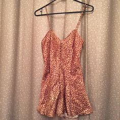 Victoria's Secret silky leopard romper lingerie S I think this is vintage VS but it's in amazing condition. It's a flattering romper that cinches at the waist and flares out. No size but I'm a small Victoria's Secret Intimates & Sleepwear Chemises & Slips
