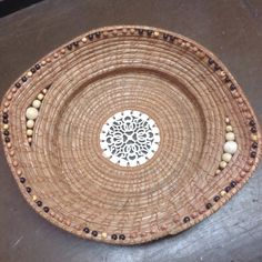 Pine needle basket with wood center and wood beads