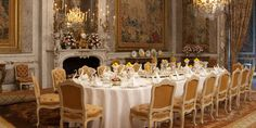 The magnificent dining room, with five mirror frames designed in the 1730s by Nicolaus Pineau for the Paris house of the Duc de Villars at Waddesdon Manor.
