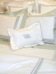 Stunning custom embroidered and monogrammed sateen sheeting, duvet cover and shams with a contrast color border. http://www.bellalino.com/Monogram%20%20Bed%20Linens/emperor%20embroidered%20linens.htm