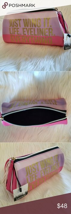 NWT* Kenzie Statement Makeup Bag* NWT* Kenzie Statement Makeup Bag* Just Wing it. Life, Eyeliner. Everything* Great Makeup Bag / Jewelry Bag / On the Go / Travel Bag* Reasonable offers accepted* Bundle & Save* Great gift, secret santa, or stocking stuffer* kenzie Bags Cosmetic Bags & Cases