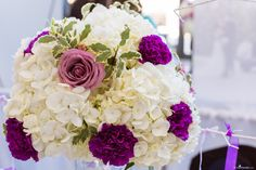 Wedding Flowers Ideas: White and Purple Reception & Ceremony Centrepiece: Roses, Hydrangeas, Carnations  @ The Ultimate Bridal Show 2015 at the Living Arts Centre, Ontario, Canada. Flowers by Peppermint Weddings, Toronto, Ontario Photo by EvaImage Photography, Toronto, Ontario
