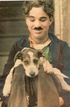 "Colorized photo. Unknown source.    I can't figure out if this is from ""A Dog's Life"" or if this is the little angel dog in ""The Kid""."