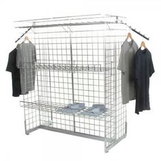 A freestanding H-shaped chrome grid panels have accessories to display clothes.