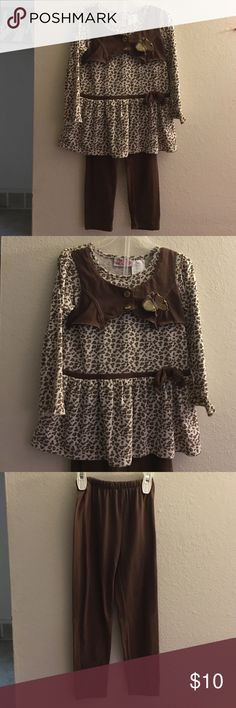 Cowgirl Inspired Animal Print Set Perfect grab and go outfit! The pants are just brown leggings but there isn't any holes or stains on them! The top is Animal Print with a brown vest (only on the front) and a gold butterfly! Young Hearts Matching Sets