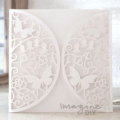 Meadow Laser Cut Range in White Laser cut wedding invitations perfect for your luxury wedding. DIY laser cuts are easy and elegant with options to insert your own printer inserts.