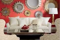 Living room decorated in warm colors. Wall decor adds interesting accents.