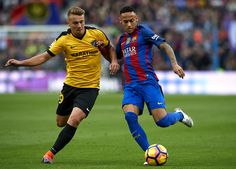 Neymar JR of Barcelona competes for the ball with Ontiveros (L) of Malaga during the La Liga match between FC Barcelona and Malaga CF at Camp Nou stadium on November 19, 2016 in Barcelona, Spain.