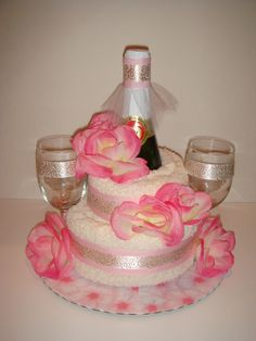 This gave me the idea to make a New Years Anniversary towel cake... pink champange with the glasses pink tulle & use confetti, ribbon curls & small balloons