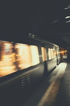 Photograph of moving train, lights are fuzzy due to movement