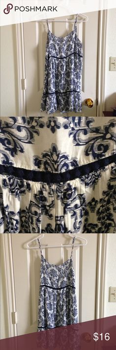 Altar'd State Blue Floral Summer Dress Blue flowy floral summer dress. Spaghetti straps that are adjustable. White and blue detailing with blue pom-poms. Size small (up to size 6). Altar'd State Dresses Mini