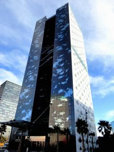 #9 (TIE) RENAISSANCE BARCELONA FIRA HOTEL — The Renaissance Barcelona Fira Hotel has a dazzling white façade except on the North side, which is black. The Barcelona hotel also has a vertical garden inside with over 300 palm trees.