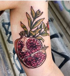 Magda Hanke pomegranate tattoo