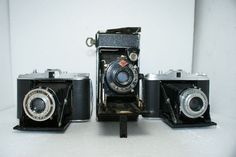 A lot of 3 folding cameras: an Agfa Isolette I, an AGFA Billy and an Agfa Isolette, various dates of production
