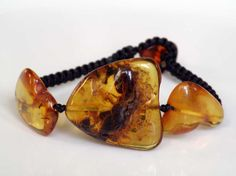 Deep orange Baltic Amber bracelet with macrame loop closing - coffee colored cord - Timeless Jewelry