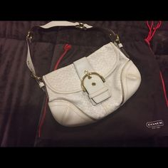 Coach purse Authentic Coach limited edition purse.  White with gold buckle.  In excellent condition even though it is used purse is in excellent condition.  Minimal pen mark on the inside. Coach Bags Clutches & Wristlets
