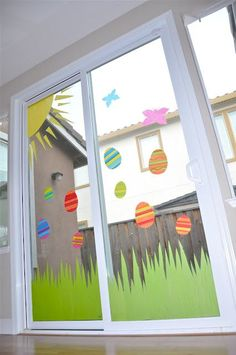 DIY Window Clings Tutorial - Tissue paper and fabric starch!! Easy peasy. Easter decorations are demonstrated, but this will be great for any holiday or party.