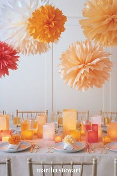 These dahlia-like bursts of color hang from the ceiling, adding charm to any party. Our tissue paper pom-poms can be made in the size and color of your choice. #marthastewart #crafts #diyideas #easycrafts #tutorials #hobby