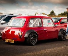 Who doesn't have a soft spot for an Austin Mini. and if you saw this epic custom parked & ready to race, tell me you couldn't stop yourself from going over to check it out & grabbing a pic. What super slick red paint & bodywork. Found via - fellow mad Mini Cooper S, Retro Cars, Vintage Cars, Classic Mini, Classic Cars, Dream Cars, Automobile, Mini Clubman, Mini S