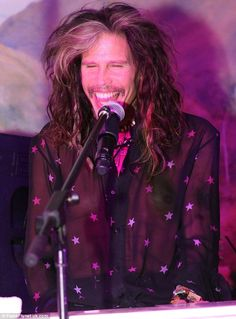 Dude looks like a lady: The Aerosmith lead singer wore a black translucent blouse with pink stars printed on it
